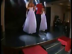 1 male 2 female lap dance in wedding dresses
