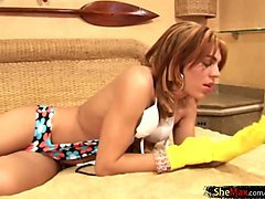 pretty blonde shemale in rubber gloves strokes her big cock
