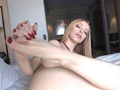 Young Woman Plays With Her Feet.