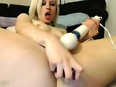 passionate blonde girl masturbating with two sex toys