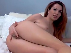 horny gal with body plays with a large ribbed dildo