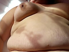 short-haired slut shows off her shaved cunt and masturbates
