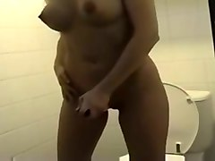 busty blonde hottie masturbating with dildo in the toilet