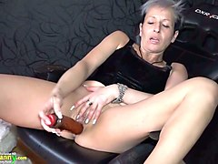 mature white punk lady on the chair playing with a dildo