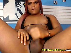 hot ebony shemale strokes her shaft