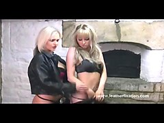 hot blonde babes tease in leather and rub their amazing big boobs together