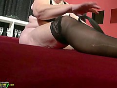 old white bbw lady in black lingerie equips herself with a strapon