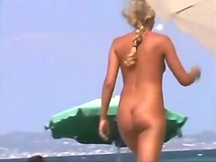 spying on amateur milf sunbathing naked on a beach