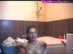 torrid latina webcam model is riding her suction cup dildo in the bathroom